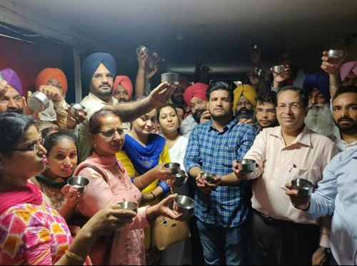 Employees protest with 'begging bowls' outside Punjab FM's office
